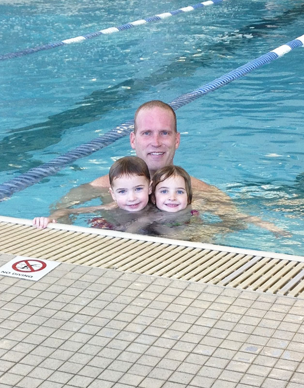 Tyghe Nielsen in swimming pool with his children